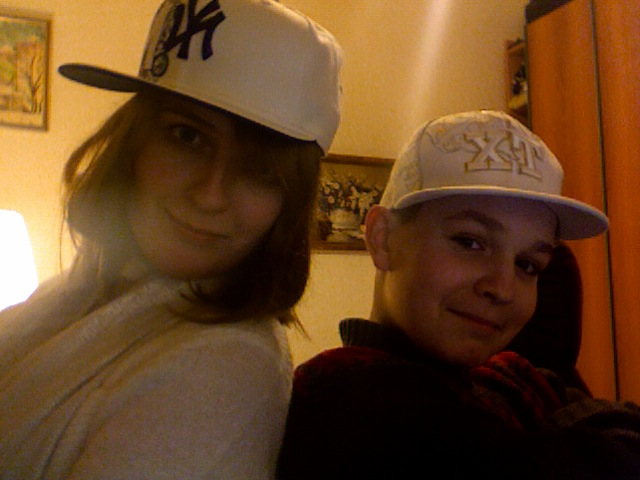 The bestest little brother in the whole world. And yours truly. Modeling hats sold exclusively in Kiev's Hip Hop Shop.