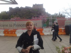 This is me. Behind me is... an assload of construction. Behind the assload, however, is the Edinburgh Castle! I went up there enjoyed the sights, and the wind, and very nearly had a seagull land on my head. I think it mistook my hair for a pastry.